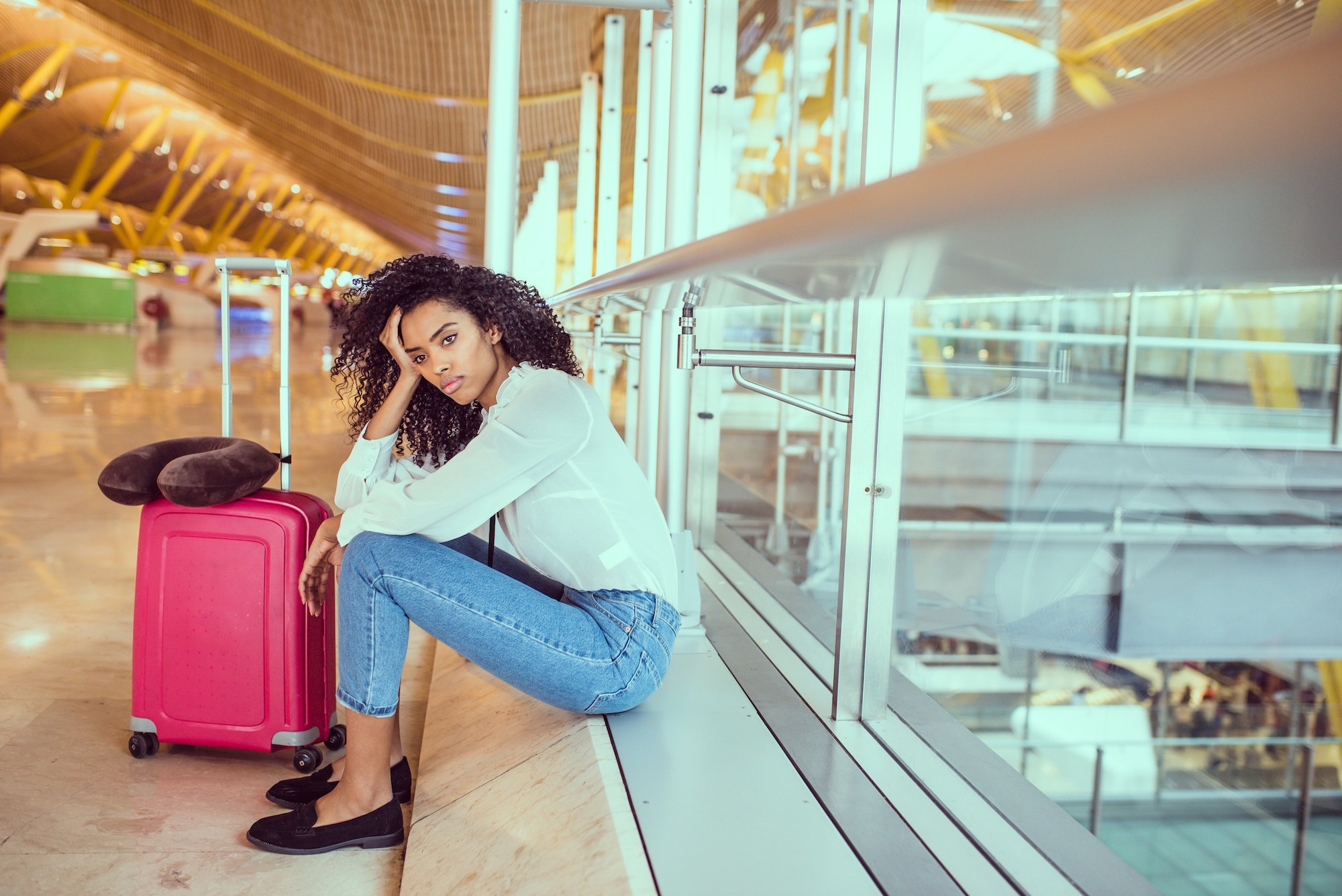 Woman sad and unhappy at the airport