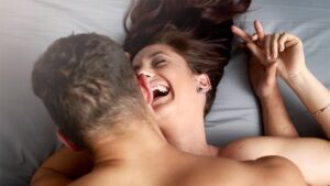 Young couple laughing while being intimate