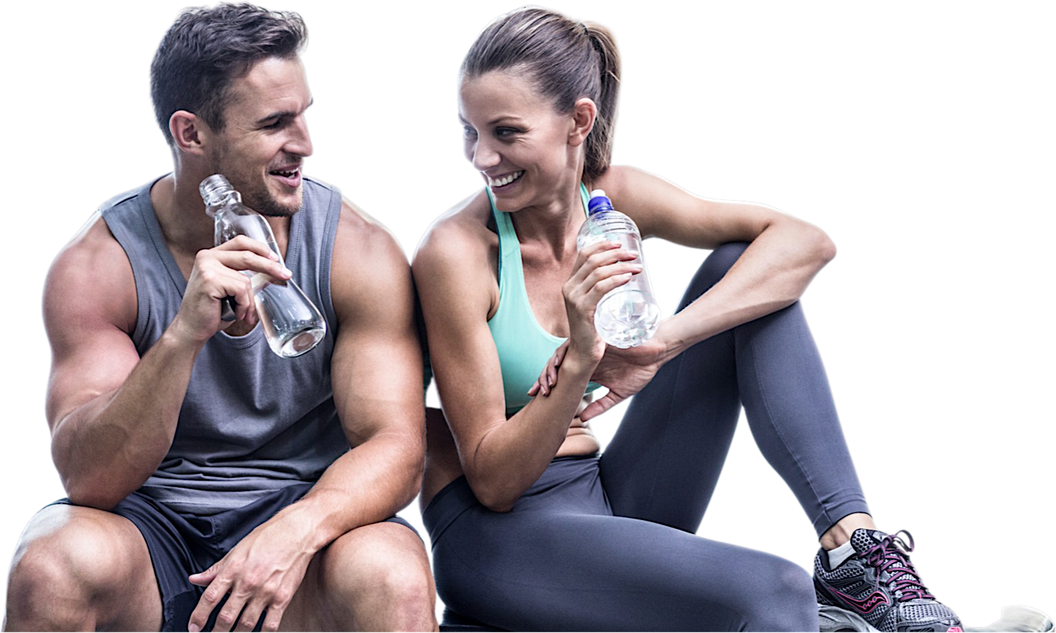 Athletic couple drinking water on bench at the gym