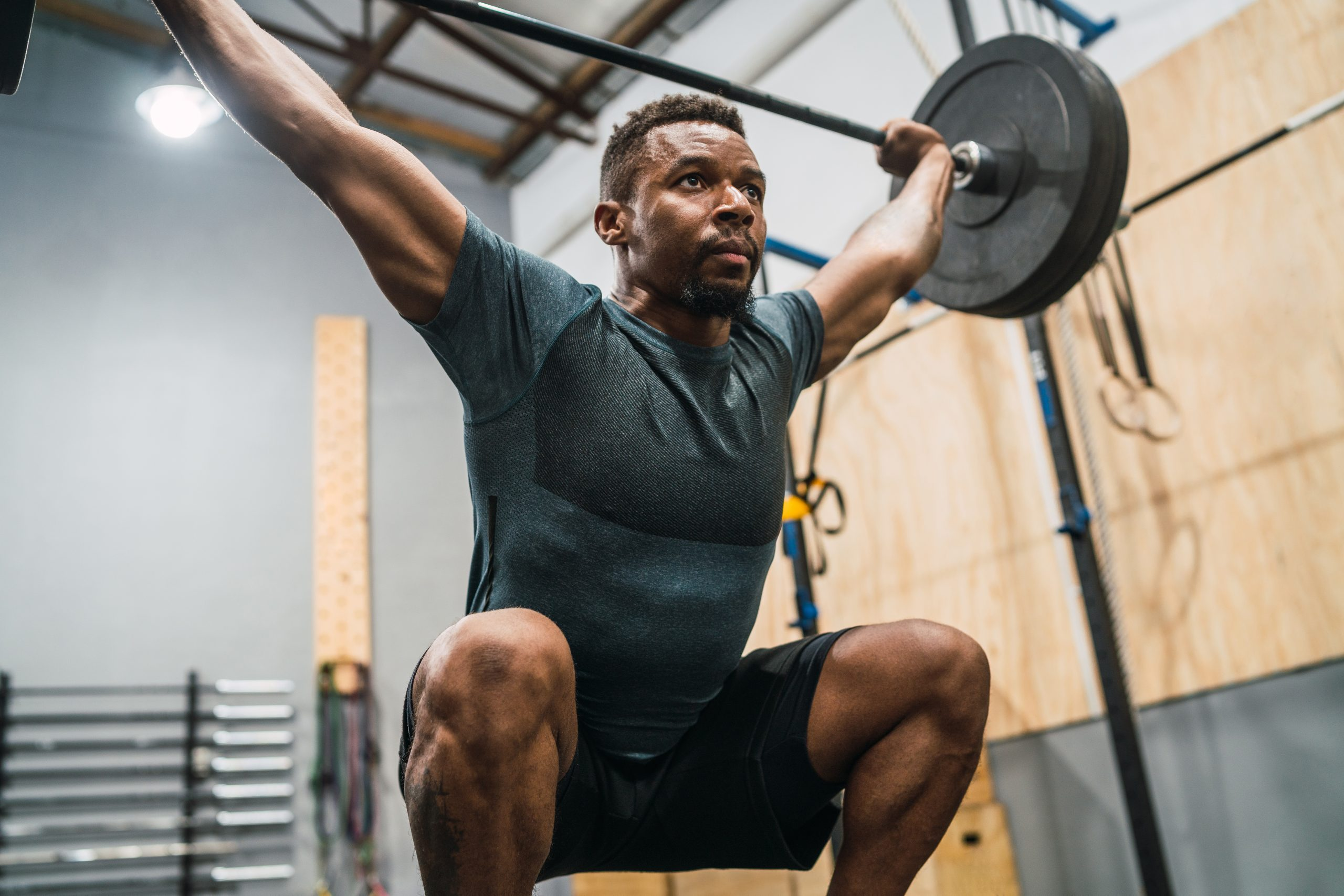 Crossfit athlete doing exercise with a barbell