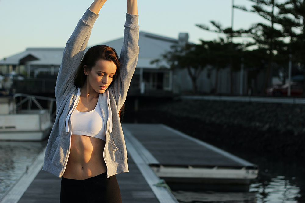 Woman stretching and thinking about the benefits of peptides