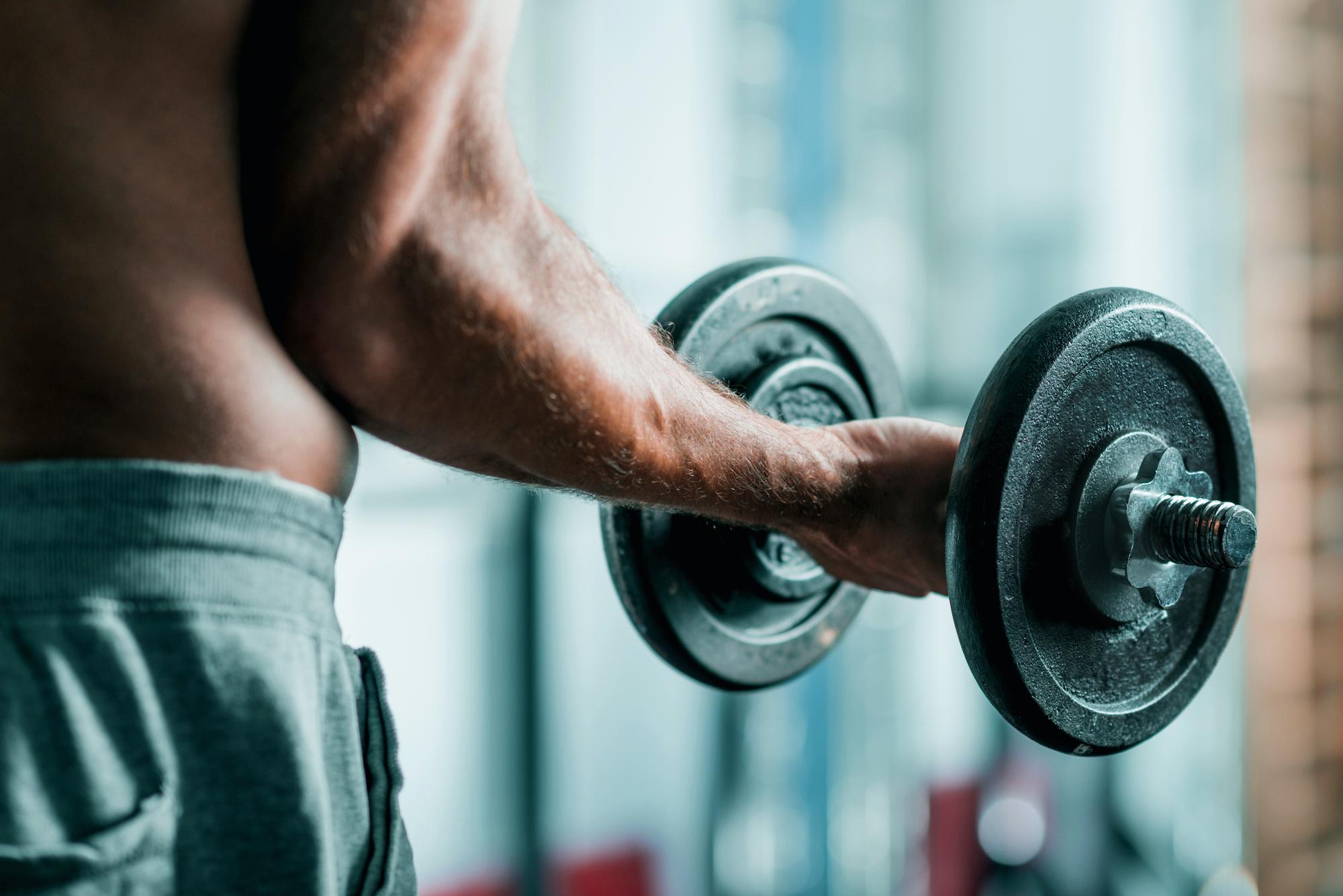 Closeup of man's arm lifting a weight