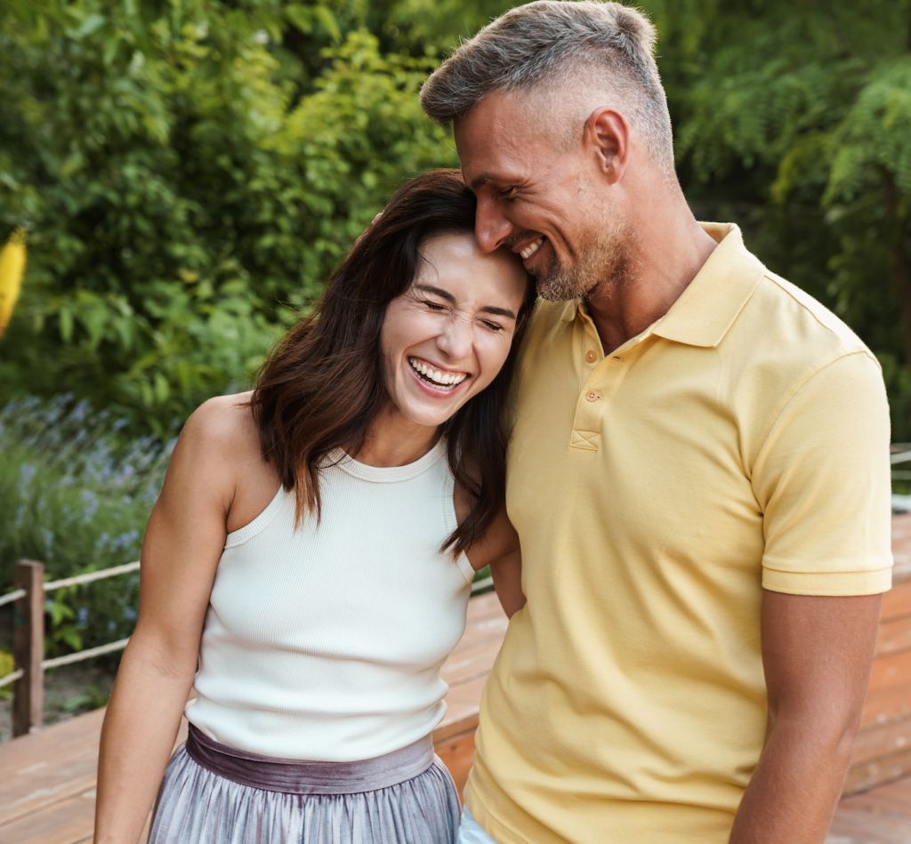 Middle-aged couple outside laughing