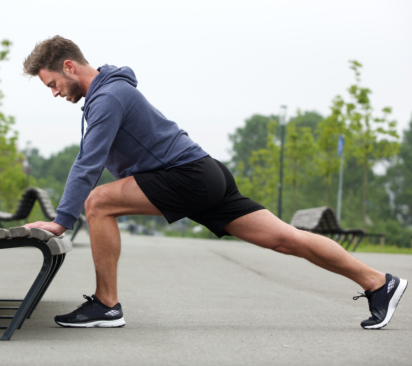 Man stretching on park bench before a run