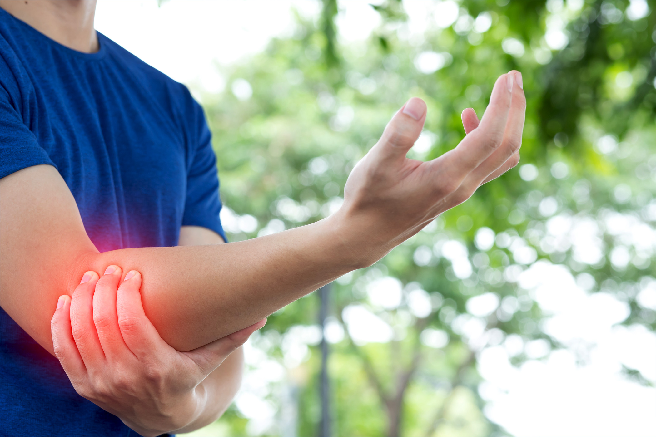Man outside with elbow pain
