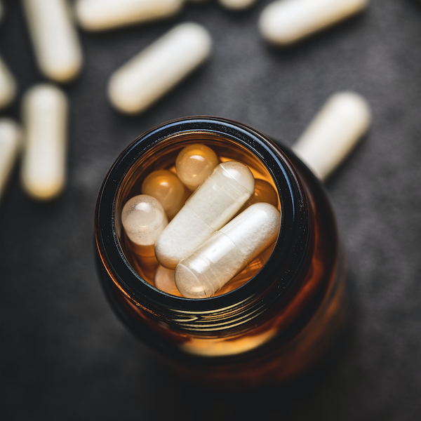 White capsules in a bottle