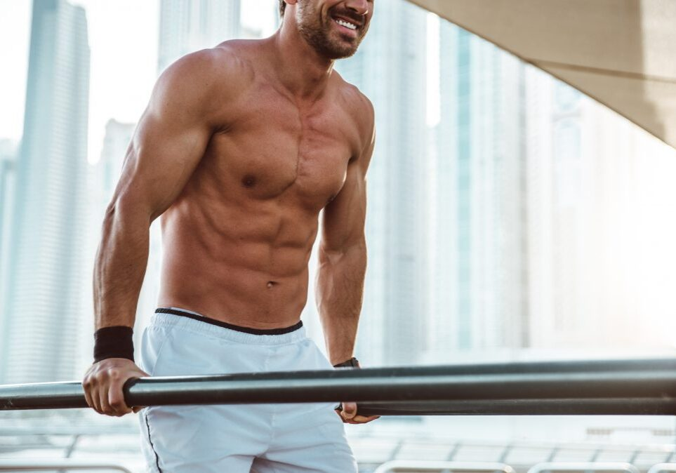 Muscular man doing work out and different exercises