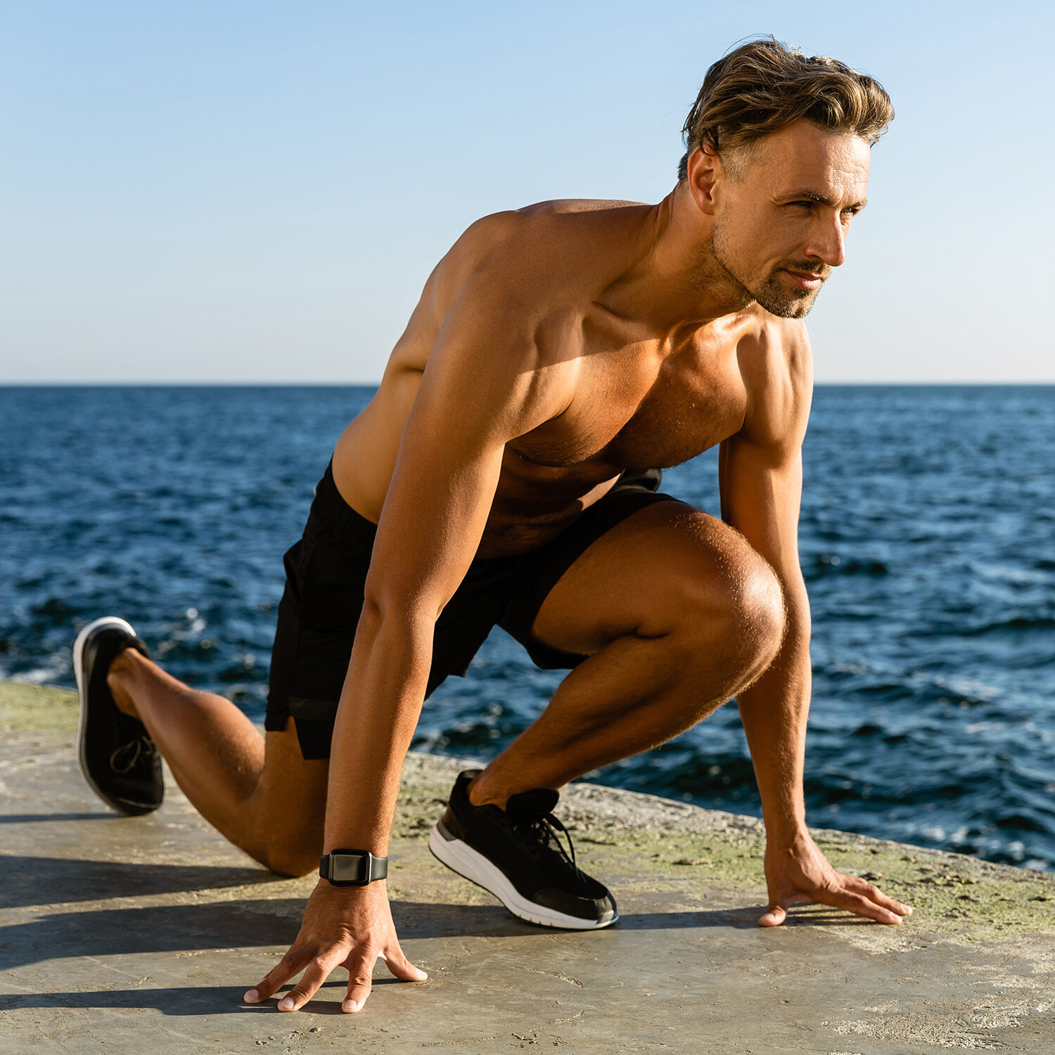 handsome-adult-shirtless-sportsman-exercising-on-s-465AWG3S