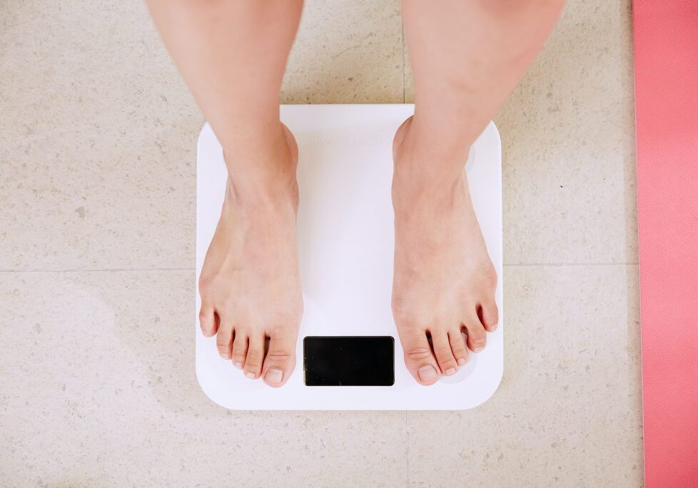 Person standing in weight scale