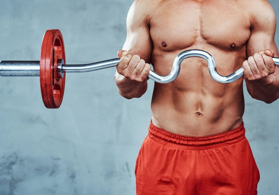 powerful-sportsman-with-formed-body-trains-weightl-KPC4P5A
