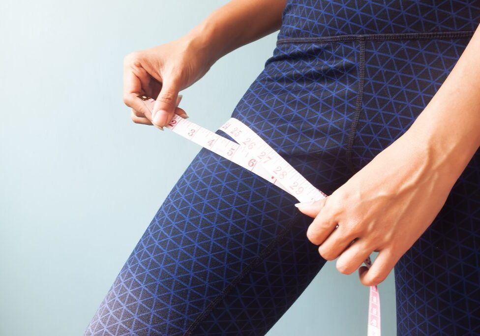 woman-measuring-her-legs-weight-loss-or-healthy-co-PV2Y83V